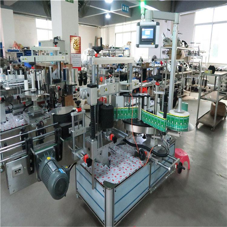 Automatyczny aplikator naklejek do etykietowania kwadratowych butelek